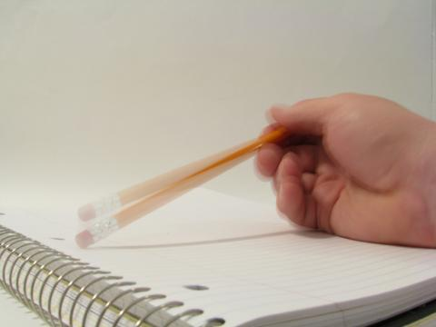 Pencil tap on notebook