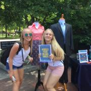 "Students holding up a ""#BuildYourBrandUMich"" sign at the University Career Center's pop-up event on the diag"